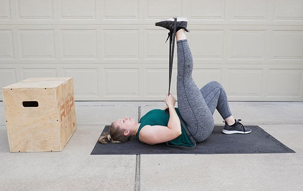 woman doing a postpartum leg stretch