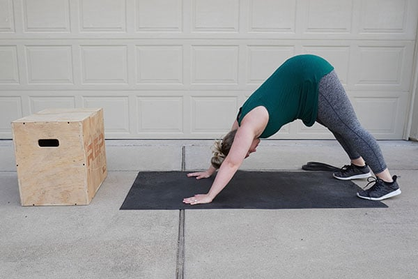 woman stretching after having a baby