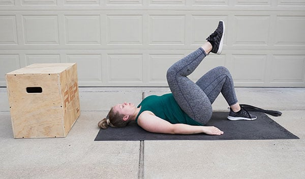 woman exercising postpartum