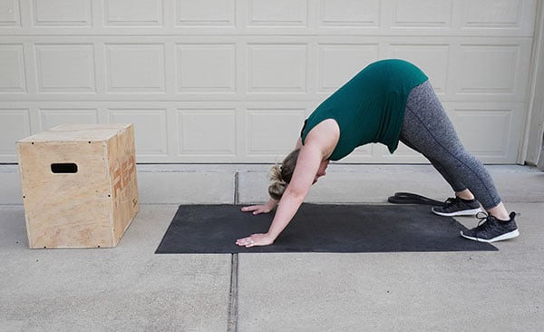 pregnant woman stretching stiff muscles